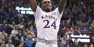 Kansas guard Lagerald Vick throws down a two handed dunk Saturday.