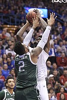 Kansas center Udoka Azubuike was fouled while going up for a shot by Eastern Michigan's James Thompson IV.