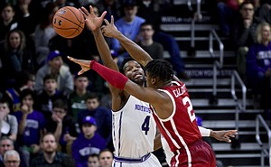 Oklahoma guard Aaron Calixte (2) passes the ball away from Northwestern forward Vic Law (4) during the first half of an NCAA college basketball game Friday, Dec. 21, 2018, in Evanston, Ill. (AP Photo/Matt Marton)