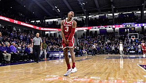 Oklahoma guard Miles Reynolds (3) celebrates the team's 76-69 overtime win against Northwestern in an NCAA college basketball game Friday, Dec. 21, 2018, in Evanston, Ill. (AP Photo/Matt Marton)