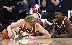 Oklahoma forward Brady Manek, left, Northwestern center Dererk Pardon, center, and Oklahoma forward Kristian Doolittle, right, fight for a loose ball during the second half of an NCAA college basketball game on Friday, Dec. 21, 2018, in Evanston, Ill. (AP Photo/Matt Marton)