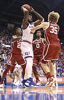 Kansas center Udoka Azubuike (35) looks to throw a pass against several Oklahoma defenders during the first half, Wednesday, Jan. 2, 2019 at Allen Fieldhouse.