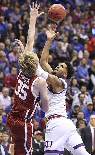 Kansas forward Dedric Lawson (1) puts a shot over Oklahoma forward Brady Manek (35) during the first half, Wednesday, Jan. 2, 2019 at Allen Fieldhouse.