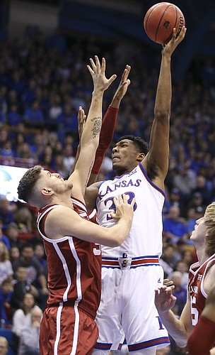 Kansas forward David McCormack (33) turns for a shot over Oklahoma forward Matt Freeman (5) during the first half, Wednesday, Jan. 2, 2019 at Allen Fieldhouse.