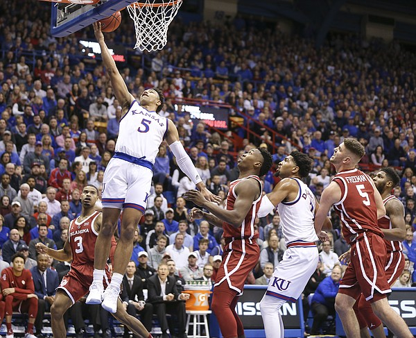 Kansas guard Quentin Grimes (5) gets in for a bucket against Oklahoma during the first half, Wednesday, Jan. 2, 2019 at Allen Fieldhouse.