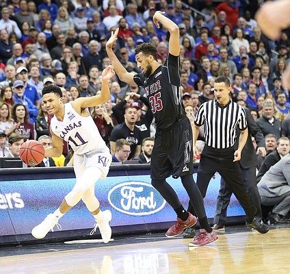 Kansas guard Devon Dotson (11) is careful not to step out of bounds after contact from New Mexico State forward Johnny McCants (35) with seconds remaining in the game on Saturday, Dec. 8, 2018 at Sprint Center.