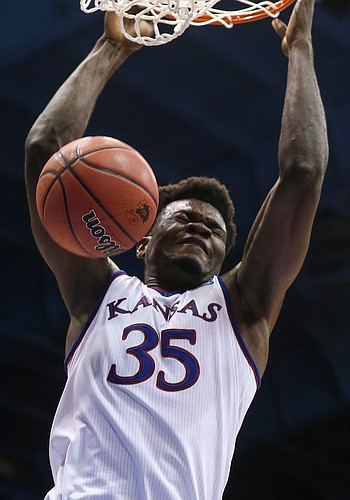 Kansas center Udoka Azubuike (35) delivers on a lob from Kansas guard Charlie Moore (2) during overtime on Saturday, Dec. 1, 2018 at Allen Fieldhouse.