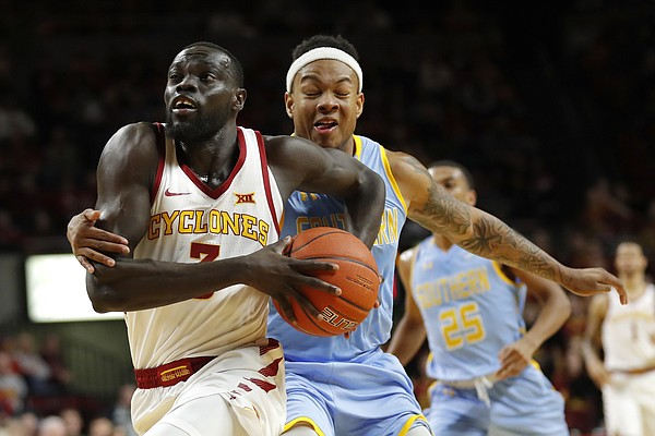 Iowa State guard Marial Shayok, left, is fouled by Southern University guard Richard Lee during the second half of an NCAA college basketball game, Sunday, Dec. 9, 2018, in Ames, Iowa. (AP Photo/Charlie Neibergall)