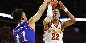 Iowa State guard Tyrese Haliburton (22) is fouled by Kansas guard Devon Dotson (11) while driving to the basket during the first half of an NCAA college basketball game, Saturday, Jan. 5, 2019, in Ames, Iowa.