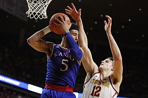 Kansas guard Quentin Grimes (5) grabs a rebound over Iowa State forward Michael Jacobson (12) during the first half of an NCAA college basketball game, Saturday, Jan. 5, 2019, in Ames, Iowa.
