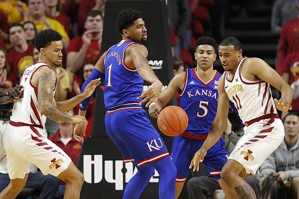 Iowa State's Talen Horton-Tucker, right, and Nick Weiler-Babb, left, fight for the ball with Kansas' Dedric Lawson, (1) and Quentin Grimes (5) during the first half of an NCAA college basketball game, Saturday, Jan. 5, 2019, in Ames, Iowa.