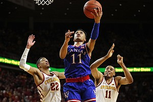 Kansas guard Devon Dotson, center, drives to the basket between Iowa State's Tyrese Haliburton, left, and Talen Horton-Tucker, right, during the second half of an NCAA college basketball game, Saturday, Jan. 5, 2019, in Ames, Iowa. (AP Photo/Charlie Neibergall)