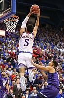 Kansas guard Quentin Grimes (5) gets up for a lob dunk over TCU guard Desmond Bane (1) during the first half, Wednesday, Jan. 9, 2019 at Allen Fieldhouse.