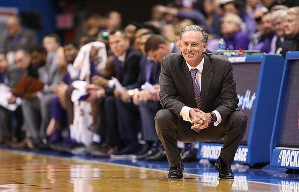 TCU head coach Jamie Dixon smiles after a call goes against the Horned Frogs during the second half, Wednesday, Jan. 9, 2019 at Allen Fieldhouse.