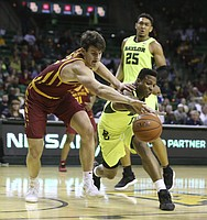 Iowa State forward Michael Jacobson, left, and Baylor guard Mark Vital reach for the ball during the first half of an NCAA college basketball game Tuesday, Jan. 8, 2019, in Waco, Texas. (AP Photo/Rod Aydelotte)