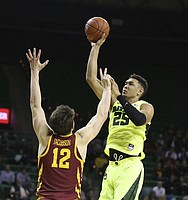 Baylor forward Tristan Clark (25) scores over Iowa State forward Michael Jacobson (12) during the second half of an NCAA college basketball game Tuesday, Jan. 8, 2019, in Waco, Texas. Baylor won 73-70. (AP Photo/Rod Aydelotte)