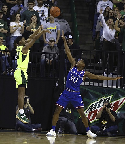 Baylor guard Jared Butler (12) shoots over Kansas guard Ochai Agbaji (30) in the first half of an NCAA college basketball game, Saturday, Jan. 12, 2019, in Waco, Texas.