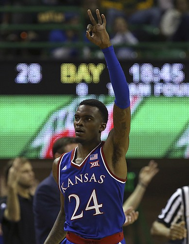 Kansas guard Lagerald Vick (24) reacts after scoring a three-point shot against Baylor in the second half of an NCAA college basketball game, Saturday, Jan. 12, 2019, in Waco, Texas. (AP Photo/Jerry Larson)