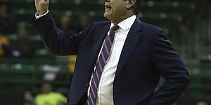 Kansas head coach Bill Self calls a play to team against Baylor in the second half of an NCAA college basketball game, Saturday, Jan. 12, 2019, in Waco, Texas. (AP Photo/Jerry Larson)