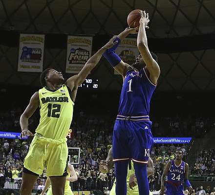 Kansas forward Dedric Lawson (1) shoots over Baylor guard Jared Butler (12) in the second half of an NCAA college basketball game, Saturday, Jan. 12, 2019, in Waco, Texas. (AP Photo/Jerry Larson)