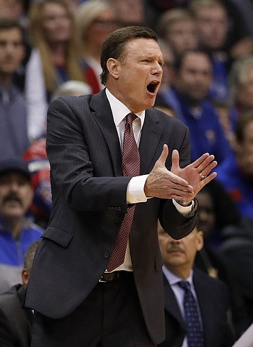 Kansas head coach Bill Self cheers on his team during the first half of an NCAA college basketball game against Texas Monday, Jan. 14, 2019, in Lawrence, Kan. (AP Photo/Charlie Riedel)