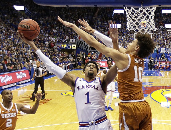 Kansas forward Dedric Lawson (1) shoots under pressure from Texas forward Jaxson Hayes (10) during the first half of an NCAA college basketball game Monday, Jan. 14, 2019, in Lawrence, Kan. (AP Photo/Charlie Riedel)
