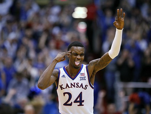 Kansas guard Lagerald Vick (24) celebrates after making a shot during the second half of an NCAA college basketball game against Texas Monday, Jan. 14, 2019, in Lawrence, Kan. Kansas won 80-78. (AP Photo/Charlie Riedel)