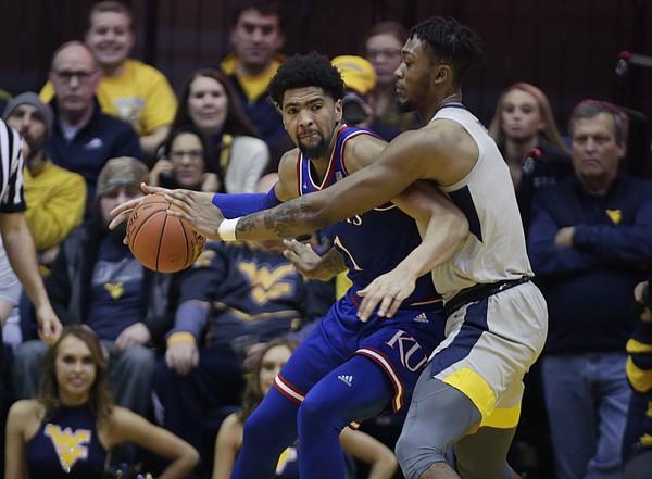 Kansas forward Dedric Lawson (1) tries to drive around West Virginia forward Derek Culver (1) during the second half of an NCAA college basketball game Saturday, Jan. 19, 2019, in Morgantown, W.Va.
