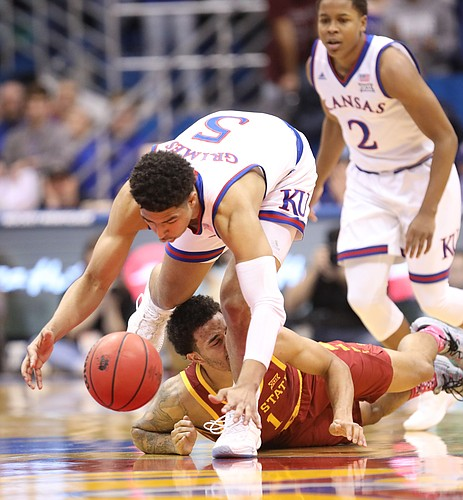Kansas guard Quentin Grimes (5) comes away with a ball from Iowa State guard Nick Weiler-Babb (1) during the first half, Monday, Jan. 21, 2019 at Allen Fieldhouse.