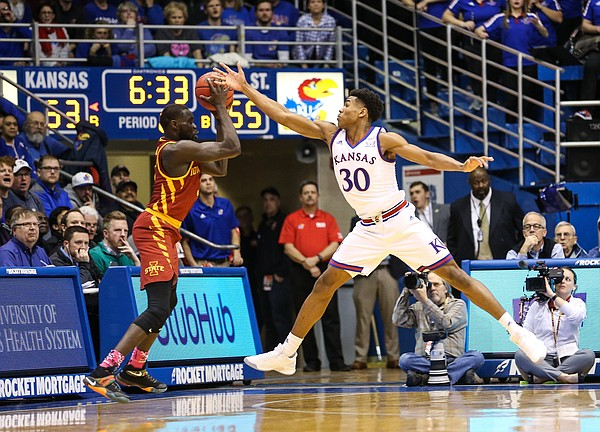 Kansas guard Ochai Agbaji (30) fouls Iowa State guard Marial Shayok (3) during the second half, Monday, Jan. 21, 2019 at Allen Fieldhouse.