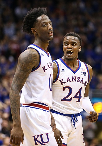 Kansas guard Lagerald Vick (24) reacts to a bucket by Kansas guard Marcus Garrett (0), front, and a foul against the Cyclones during the second half, Monday, Jan. 21, 2019 at Allen Fieldhouse.