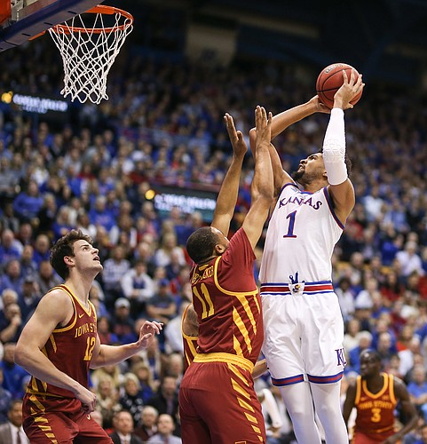 Kansas forward Dedric Lawson (1) puts up a shot over Iowa State guard Talen Horton-Tucker (11) during the first half, Monday, Jan. 21, 2019 at Allen Fieldhouse.