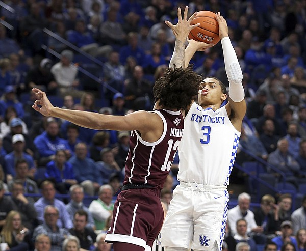 Kentucky's Keldon Johnson (3) shoots while defended by Texas A&M's Brandon Mahan (13) during the first half of an NCAA college basketball game in Lexington, Ky., Tuesday, Jan. 8, 2019. (AP Photo/James Crisp)
