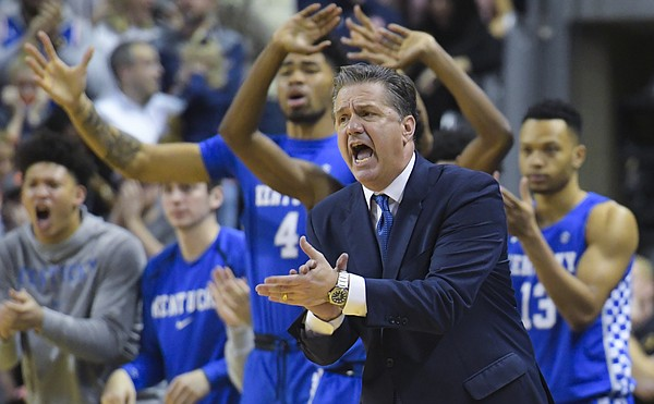 Kentucky head coach John Calipari cheers from the bench during the second half of an NCAA college basketball game against Auburn Saturday, Jan. 19, 2019, in Auburn, Ala. (AP Photo/Julie Bennett)