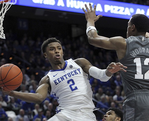 Kentucky's Ashton Hagans (2) passes around Mississippi State's Robert Woodard (12) during the second half of an NCAA college basketball game in Lexington, Ky., Tuesday, Jan. 22, 2019. Kentucky won 76-55. (AP Photo/James Crisp)