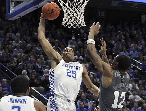 Kentucky's PJ Washington (25) dunks while defended by Mississippi State's Robert Woodard (12) during the second half of an NCAA college basketball game in Lexington, Ky., Tuesday, Jan. 22, 2019. Kentucky won 76-55. (AP Photo/James Crisp)