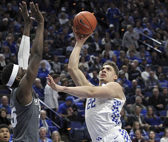 Kentucky's Reid Travis (22) shoots while defended by Mississippi State's Aric Holman (35) during the second half of an NCAA college basketball game in Lexington, Ky., Tuesday, Jan. 22, 2019. Kentucky won 76-55. (AP Photo/James Crisp)