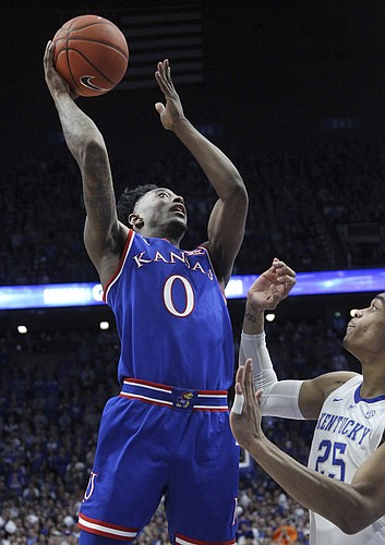 Kansas' Marcus Garrett (0) shoots while defended by Kentucky's PJ Washington during the second half of an NCAA college basketball game in Lexington, Ky., Saturday, Jan. 26, 2019. Kentucky won 71-63. (AP Photo/James Crisp)