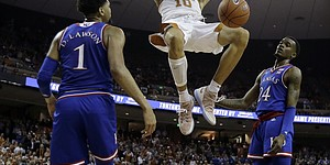 Texas forward Jaxson Hayes (10) celebrates as he scores over Kansas forward Dedric Lawson (1) and guard Lagerald Vick (24) during the second half on an NCAA college basketball game in Austin, Texas, Tuesday, Jan. 29, 2019. Texas won 73-63. (AP Photo/Eric Gay)