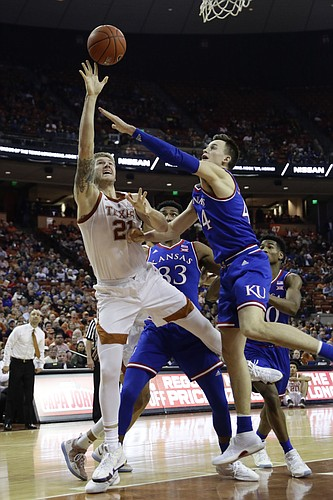 Texas forward Dylan Osetkowski (21) shoots over Kansas forward Mitch Lightfoot (44) during the second half on an NCAA college basketball game in Austin, Texas, Tuesday, Jan. 29, 2019. Texas won 73-63. (AP Photo/Eric Gay)