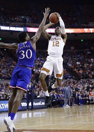 Texas guard Kerwin Roach II (12) shoots over Kansas guard Ochai Agbaji (30) during the second half on an NCAA college basketball game in Austin, Texas, Tuesday, Jan. 29, 2019. Texas won 73-63. (AP Photo/Eric Gay)