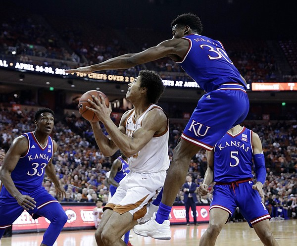 Texas forward Jericho Sims, looks to shoot as Kansas guard Ochai Agbaji (30) defends during the second half on an NCAA college basketball game in Austin, Texas, Tuesday, Jan. 29, 2019. Texas won 73-63. (AP Photo/Eric Gay)