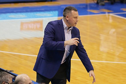 KU coach Brandon Schneider shouts out to his players in a game against Oklahoma at Allen Fieldhouse, January 30. Kansas won 88-79.