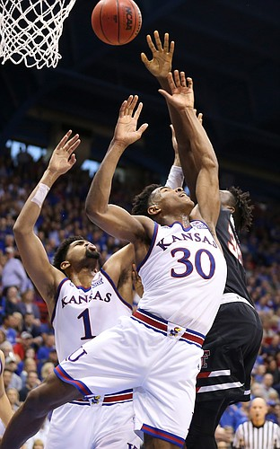 Kansas guard Ochai Agbaji (30) and Kansas forward Dedric Lawson (1) fight for a rebound from Texas Tech forward Josh Mballa (35) during the second half, Saturday, Feb. 2, 2019 at Allen Fieldhouse.