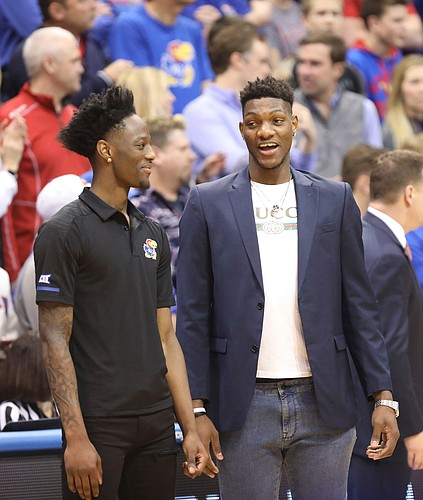 Kansas forward Silvio De Sousa, right, talks with Kansas guard Marcus Garrett before tipoff, Saturday, Feb. 2, 2019 at Allen Fieldhouse.