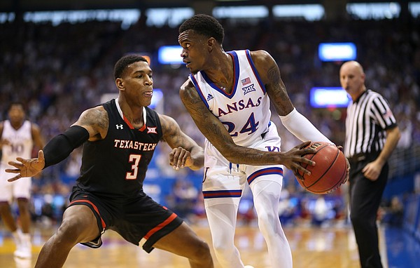 Kansas guard Lagerald Vick (24) is defended in the corner by Texas Tech forward Deshawn Corprew (3) during the first half, Saturday, Feb. 2, 2019 at Allen Fieldhouse.