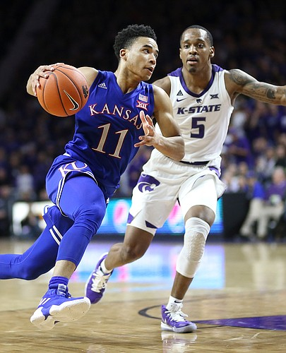 Kansas guard Devon Dotson (11) drives against Kansas State guard Barry Brown Jr. (5) during the second half, Tuesday, Feb. 5, 2019 at Bramlage Coliseum.