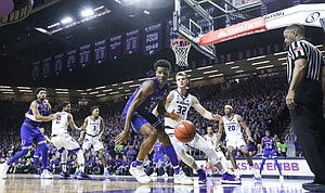 Kansas guard Ochai Agbaji (30) is defended by Kansas State forward Dean Wade (32) along the baseline during the second half, Tuesday, Feb. 5, 2019 at Bramlage Coliseum.