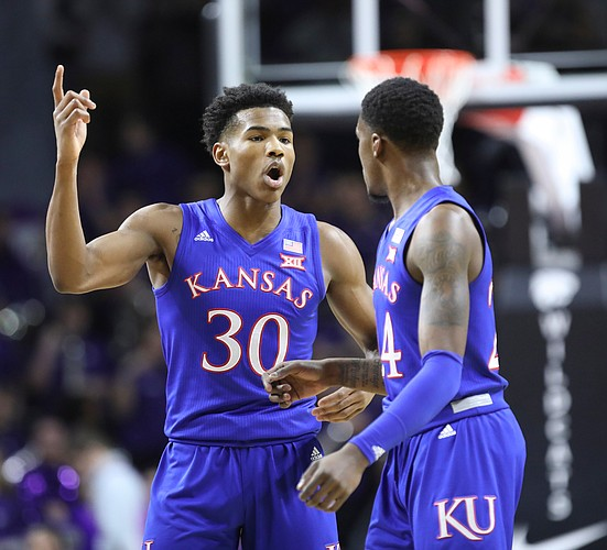 Kansas guard Ochai Agbaji (30) and Kansas guard Lagerald Vick (24) have a conversation during the first half, Tuesday, Feb. 5, 2019 at Bramlage Coliseum.