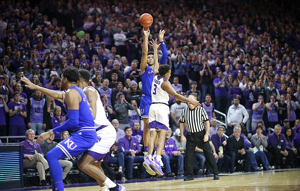 Kansas guard Quentin Grimes (5) puts up a three over Kansas State guard Kamau Stokes (3) during the first half, Tuesday, Feb. 5, 2019 at Bramlage Coliseum.